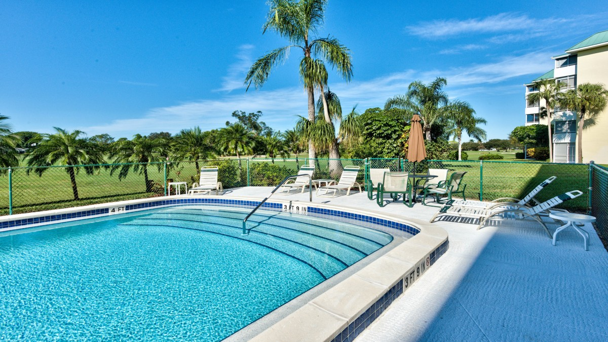 Pool Located Right Behind Building; 1 Minute Walk from Condo! Beautiful Golf Views and Ample Lounging; Heated During Season!