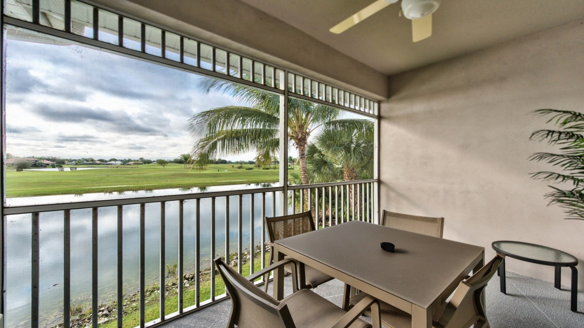 Private Lanai with Table and Seating; Fan; Overlooking Scenic Lake and Championship Golf Courses! Breathtaking Views of Sunrise!